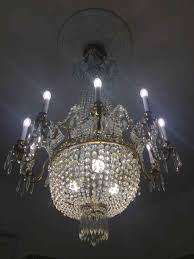 An Ornate Chandelier Is A Centrepiece In The Living Room