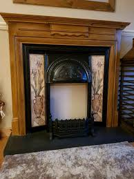 dark wood fireplace grate and hearth