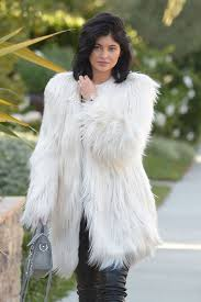 kylie jenner in los angeles california wearing a faux fur coat from guess