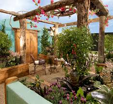 tree trunk pergola with flowers and outdoor furniture