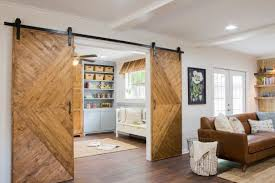 as seen on fixer upper the phipps rennovated home now has a children s playroom off from the living room with barn doors for privacy when the room is used