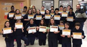 students win top honours in knights of columbus essay writing contest john madalena and his grade 8 class their certificates of participation photo by sir