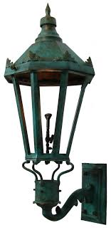 choosing the right outdoor lighting fixtures is a critical finishing touch to a new home or a newly refreshed home gas lanterns can be the jewels that make