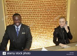 stock photo washington dc 9th street nw renaissance hotel black man woman clerk front desk job customer service lodging hospitality registra