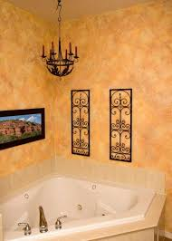 enticing faux bathroom walls with corner tub and black antique chandelier for traditional interior