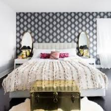 Glamorous Bedroom With Gray and White Wallpaper Accent Wall