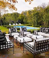 outdoor wrought iron furniture. chic patio features wrought iron sofas chairs and ottomans covered in black white cushions placed front of the inground pool outdoor furniture e