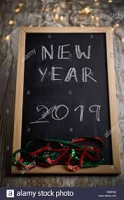 Chalkboard With Lights Black Chalkboard With Written Words New Year 2019 Surrounded