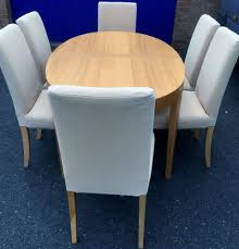 extending oval dining table and 6 chairs ikea table cream light wood chairs