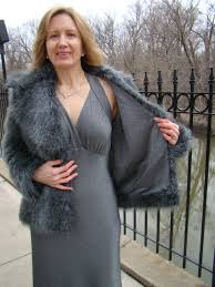 the coat is a simple boxy style two jacket fronts jacket back on a fold two sleeves collar and lapels the faux fur is long pile meaning the hairs are