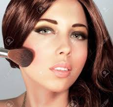picture of pretty woman with stylish makeup cute holding brush for blush y