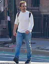 On the move: Gerard Butler, 50, wore a plain white shirt and jeans while  running, walking ... in 2020 | Gerard butler, Gerard, Butler