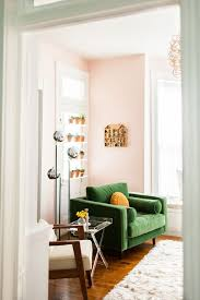 green room furniture. retro room look green sofa and blush walls furniture