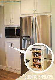 a built in microwave is located in the center of a tall pantry microwave pantry microwave pantry