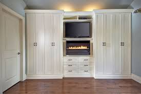 antique white custom builtin in fireplace media center wall unit