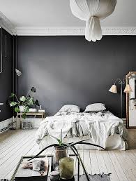 Black walls in this bedroom give it a surprisingly cosy look and without  taking away from