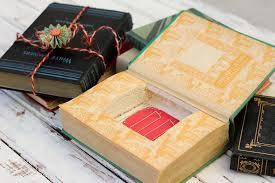 turn an old vine book into an keepsake diy gift box with this simple tutorial