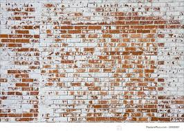 an old brick wall with ling white paint