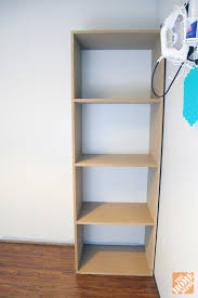 diy laundry room storage shelves in place