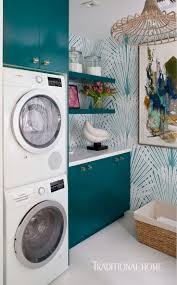 A teal palm-leaf wallcovering jazzes up the walls in this showhouse laundry  room. - Photo: Michael Garland / Design: Denise McGaha The best Texas  interior ...