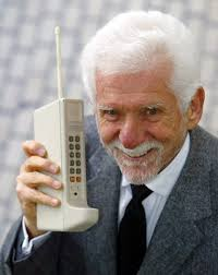 first motorola cell phone 1973. in this 2003, photo, martin cooper, chairman and chief executive of arraycomm, holds a motorola dynatac, 1973 prototype the first hand-held cellular cell phone