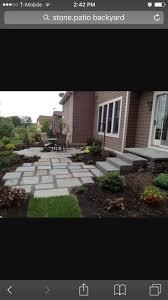 Backyard Flagstone Patio and Gardens in Maple Grove, Minnesota contemporary  landscape