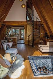 A 1963 A-frame home redesigned by Desanka, it& filled with her discerning  creative touches. Her earthy style effortlessly complements the natural  wood ...