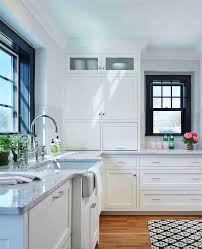 fabulous kitchen features white shaker cabinets painted benjamin moore white dove paired with roman white granite countertops and a gray subway tiled