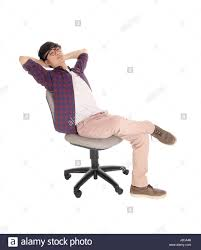 Leaning Chair Design A Young Asian Man Sitting On An Office Chair Leaning Back