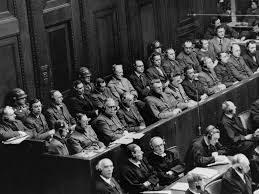 online exhibition united states holocaust memorial museum defendants seated under guard in the dock behind the defense counsel during the doctors trial