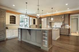 spacious kitchen in traditional style with white and brown cabinetry