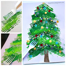 Fork painted Christmas tree - winter arts and crafts projects for kids.  Stamp and paint