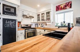 small kitchen with wood countertops white cabinets with chalkboard doors