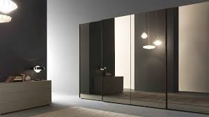 awesome glass mirrored sliding door wardrobe with beige wood cabinet and dark grey wall also unique