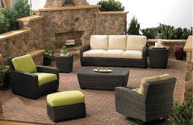 patio furniture ideas outdoor. Outdoor Stone Fireplace Facing Patio Furniture With Wicker Material On Brown Brick Flooring Ideas U
