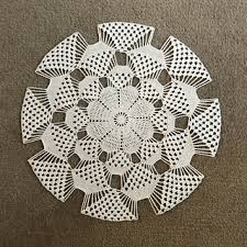 table topper in 3D pattern by Cindi Edwards - Ravelry