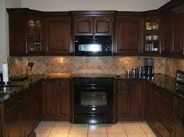 Cherry Kitchen Cabinets With Gray Wall And Quartz Countertops ...