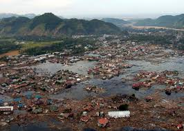 essay earthquake earthquake research papers essay on tsunami essay  tsunami the killer wave the why files aerial view of flooded village debris strewn throughout mountains