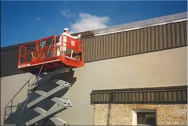 painter on lift commercial exterior painting contractor painter connecticut