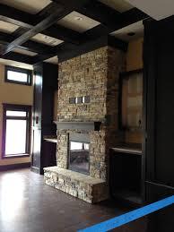stacked stone veneer interior fireplace