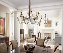 rustic black rectangle chandelier over traditional dining set in contemporary traditional chandeliers dining room