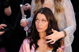 paris france november 30 bella hadid has her hair makeup done prior the 2016 victoria s secret fashion show on november 30 2016 in paris france