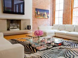 decorating a large wall with a flat screen tv for living room using extra large cowhide rug also modern glass table