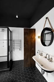 sliding bathroom mirror: vintage round bathroom mirror with black floor also using sliding glass door and two faucet sink
