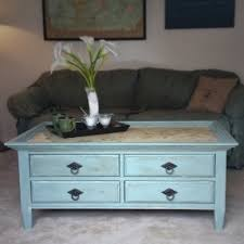 we found a beat up coffee table with drawers and interesting architectural features we painted chalk paint coffee table