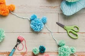 celebrate the start of the school year a special birthday or your every day love of mickey mouse this pom pom garland will add just a little festive diy