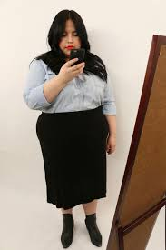 person looking in full length mirror. the mirror selfie: i always look for a full-size mirror when enter room. selfie is the best way to show off your #ootd. person looking in full length