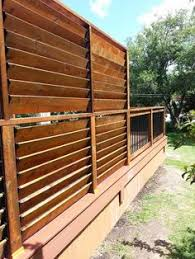 FLEXfence creation by Thommoknockers Custom Decks. Backyard Privacy Screen