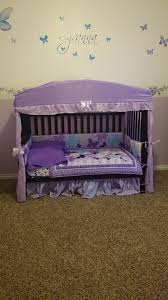 Toddler bed, converted from crib. Found the cute canopy at Ross ...