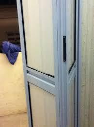 bifold bathroom doors. the hive singapore hostel: folding door of bathroom bifold doors